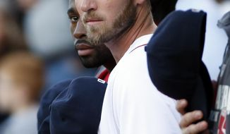 Newly signed Boston Red Sox player Stephen Drew stands with teammates for the national anthem prior to a baseball game against the Toronto Blue Jays at Fenway Park in Boston, Wednesday, May 21, 2014. (AP Photo/Elise Amendola)