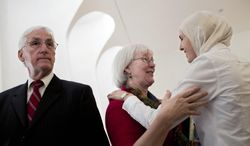 Cindy Corrie, center, and Craig Corrie, left, the parents of Rachel Corrie, a pro-Palestinian activist who was crushed to death by an Israeli bulldozer in Gaza in 2003, meet their lawyer at the Supreme Court In Jerusalem, Wednesday, May 21, 2014. The family of slain American activist Rachel Corrie asked Israel's Supreme Court on Wednesday to overturn a verdict clearing the military of any wrongdoing in her death. Corrie, 23, was crushed to death by an Israeli military bulldozer during a protest in the Gaza Strip in March 2003. (AP Photo/Oded Balilty)