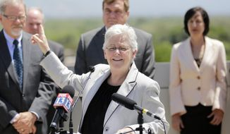 U.S. Environmental Protection Agency administrator Gina McCarthy makes remarks during a news conference Wednesday, May 21, 2014, in Salt Lake City. The head of the EPA was in Salt Lake City Tuesday to talk about the agency's efforts to reduce carbon pollution. The Utah appearance by EPA administrator McCarthy is her first stop in a three-city tour that also includes Seattle and Portland. She is meeting with politicians, local leaders and business people as the EPA tries to implement President Barack Obama's climate-change plan. (AP Photo/Rick Bowmer)