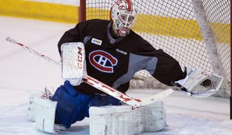 Montreal Canadiens goalie Dustin Tokarski makes a save during the team's practice Wednesday, May 21, 2014 in Brossard, Quebec.  The Canadiens play the New York Rangers in Game 3 of the Eastern Conference final of the Stanley Cup Playoffs on Thursday in New York. (AP Photo/The Canadian Press, Ryan Remiorz)