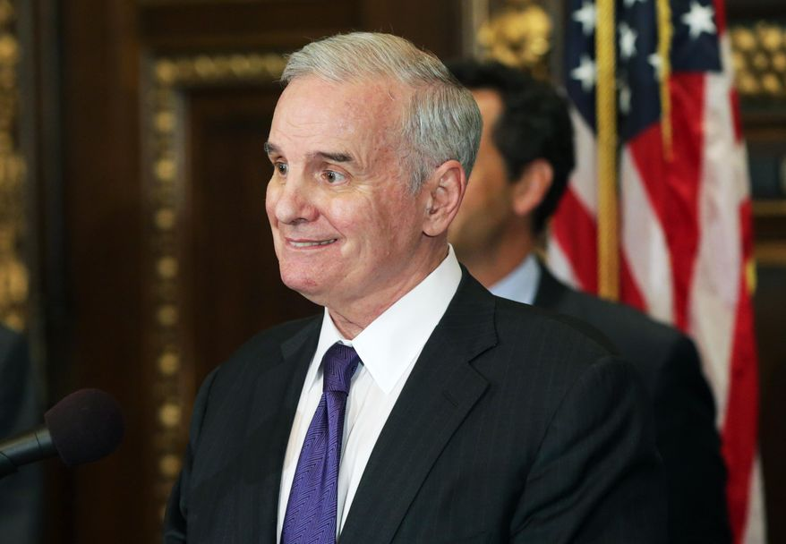 Minnesota Gov. Mark Dayton smiles after a question during a news conference at the State Capitol, May 21, 2014 in St. Paul. Minn., where he hosted the presentation leaders who helped bring the National Football League's 2018 Super Bowl to Minneapolis.  . (AP Photo/Jim Mone)