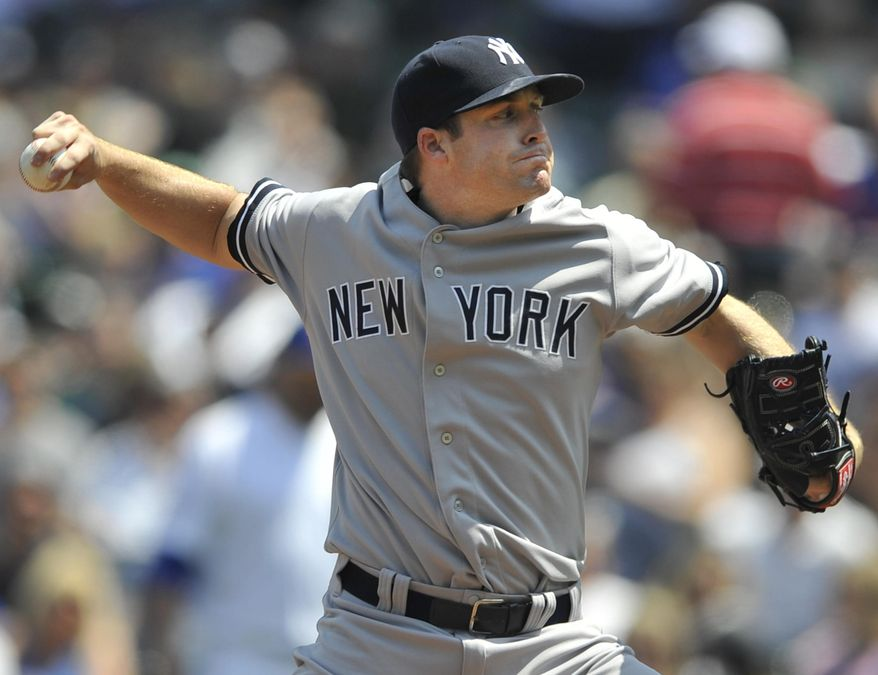 New York Yankees starter Chase Whitley delivers a pitch during the first inning of an interleague baseball game against the Chicago Cubs in Chicago, May 21, 2014. (AP Photo/Paul Beaty)