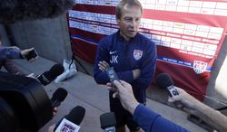 U.S. men's soccer coach Jurgen Klinsmann fields questions during the team's training camp in preparation for the World Cup, Wednesday, May 21, 2014, in Stanford, Calif. (AP Photo/Marcio Jose Sanchez)