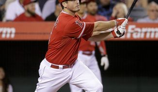 Los Angeles Angels' David Freese watches his RBI-double against the Houston Astros during the sixth inning of a baseball game in Anaheim, Calif., Tuesday, May 20, 2014. (AP Photo/Chris Carlson)