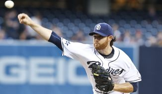 San Diego Padres starting pitcher Ian Kennedy throws against the Minnesota Twins during the first inning of a baseball game Tuesday, May 20, 2014, in San Diego.  (AP Photo/Lenny Ignelzi)