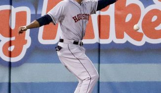 Houston Astros left fielder Jesus Guzman can't get a glove on a double by Los Angeles Angels' Albert Pujols during the second inning of a baseball game in Anaheim, Calif., Tuesday, May 20, 2014. (AP Photo/Chris Carlson)