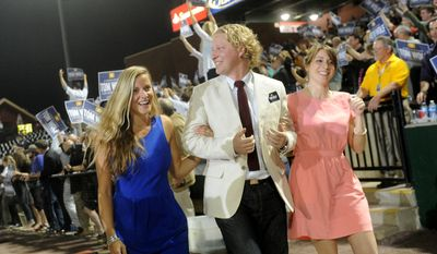 Rep. Kevin Schreiber escorts Tom Wolf's daughters Katie, left, and Sarah for the rally at Santander Stadium to celebrate Wolf's win as the Democratic nominee on Tuesday, May 20, 2014.  (AP Photo/York Daily Record, Jason Plotkin)