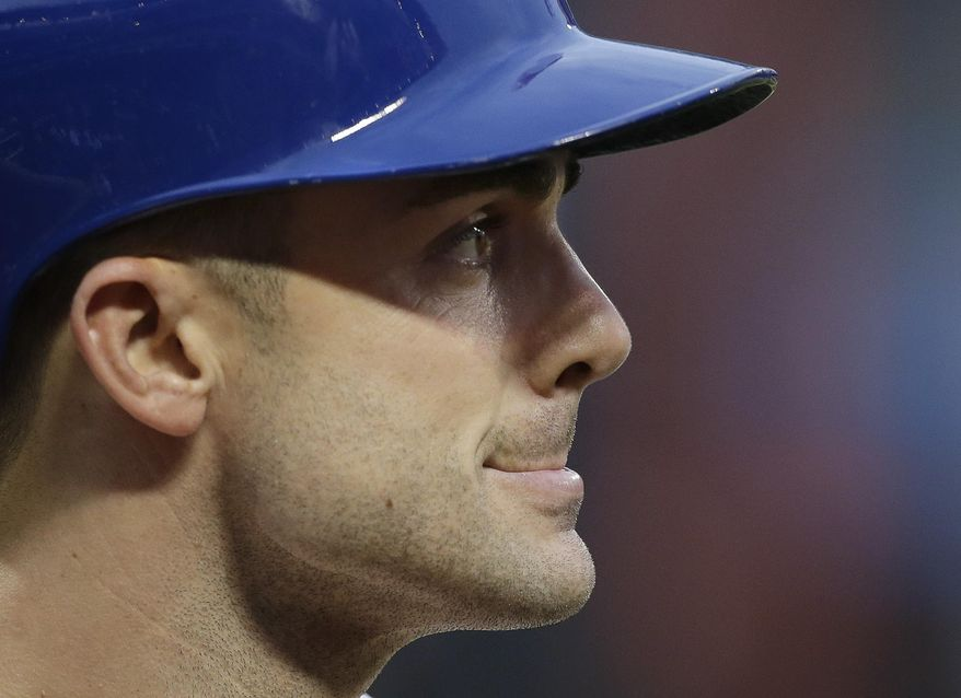 New York Mets' David Wright walks back to the dugout after striking out against the Los Angeles Dodgers during the first inning of a baseball game, Wednesday, May 21, 2014, in New York. (AP Photo/Julie Jacobson)