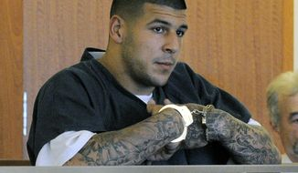 FILE - In this June 27, 2013 file photo, former New England Patriots football standout Aaron Hernandez stands during a bail hearing in Superior Court in Fall River, Mass., charged with killing Odin Lloyd. Hernandez is scheduled to be arraigned May 28, 2014, on two unrelated murder charges in the 2012 shooting deaths of Daniel de Abreu and Safiro Furtado in Boston. Prosecutors are also seeking assistance from tattoo artists who may have inked Hernandez's right arm between February 2012 and June 2013. The tattoo artists are considered witnesses, not suspects. (AP Photo/Boston Herald, Ted Fitzgerald, Pool, File)