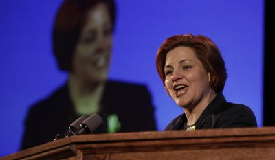 Former New York City Council Speaker Christine Quinn addresses the opening session of the state's Democratic Convention, in Melville, N.Y., Wednesday, May 21, 2014. (AP Photo/Richard Drew)