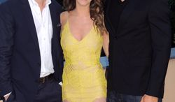 In this photo taken on Tuesday, May 20, 2014, from left, television personality Ben Lyons, actress Jacqueline MacInnes Wood and actor Kellan Lutz pose prior to a dinner at the Terre Blanche Hotel Spa Golf Resort in Tourrettes, France. Guests were invited to the property as a break from the Cannes Film Festival which is taking place in nearby Cannes. (AP Photo/Nekesa Moody)