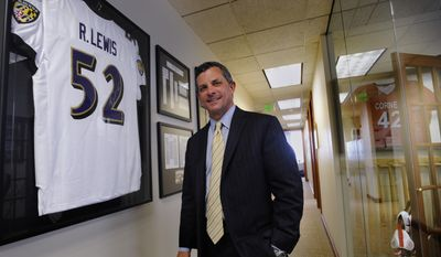 Attorney Steve Silverman stands in a hallway outside his office Tuesday, May 20, 2014, in Baltimore. A group of retired players accused the NFL in a lawsuit Tuesday of cynically supplying them with powerful painkillers and other drugs that kept them in the game but led to serious complications later in life. The lawsuit, which seeks unspecified damages on behalf of more than 500 ex-athletes, charges the NFL with putting profits ahead of players' health. Silverman is an attorney for the players. (AP Photo/Gail Burton)