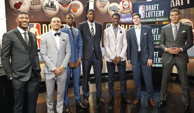 From left, NBA draft prospects Marcus Smart of Oklahoma State, Tyler Ennis of Syracuse, Andrew Wiggins and Joel Embiid of Kansas, Noah Vonleh of Indiana, Doug McDermott of Creighton and Aaron Gordon of Arizona pose for a photograph before the NBA basketball draft lottery in New York, Tuesday, May 20, 2014. (AP Photo/Kathy Willens)