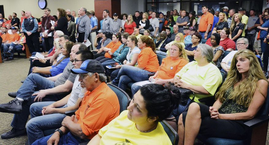 In this photo taken May 20, 2014, people fill the Fort Wayne city council meeting during dueling presentations over three proposals affecting collective bargaining for city employees at Citizens Square in Fort Wayne, Ind. There wasn't standing room left and the overflow rooms were also full. (AP Photo/The Journal-Gazette, Cathie Rowand) NEWS-SENTINEL OUT; MANDATORY CREDIT; NO SALES; MAGS OUT.