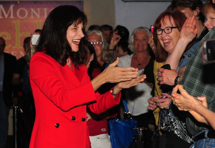 Dr. Monica Wehby greets supporters at the headquarters in Oregon City, Oregon after winning the Oregon Republican Primary race for Senate on Tuesday, May. 20, 2014. (AP Photo/Steve Dykes)