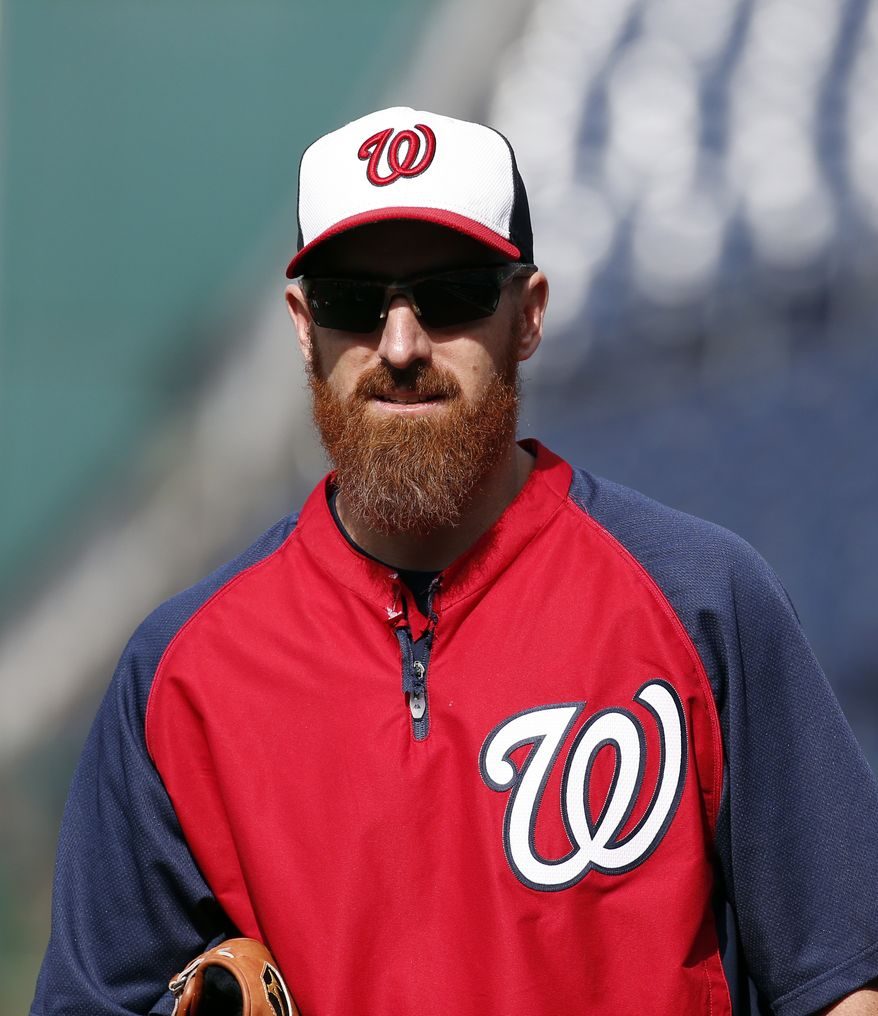 Washington Nationals first baseman Adam LaRoche (25) walks on the field during warm ups before a baseball game against the Cincinnati Reds at Nationals Park Monday, May 19, 2014, in Washington. (AP Photo/Alex Brandon)