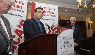 Senator Ted Cruz, (R-TX), left, congratulates Congressman Ralph Hall, (R-TX) after Hall received the Founding Spirit Award during the Honoring Our Veterans and Veterans in Congress program at the Capitol Hill Club on Wednesday, May 21. Khalid Naji-Allah/ Special for The Washington Times