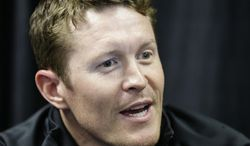 FILE - In this May 23, 2013 file photo, Scott Dixon, of New Zealand, responds to a question during a media interview for the Indianapolis 500 auto race at the Indianapolis Motor Speedway in Indianapolis. While his team struggled with both setup and speed, Dixon has flown under the radar during preparations for the Indianapolis 500. It's exactly how he wants it, and how he's tried to be his entire career.(AP Photo/Darron Cummings, File)