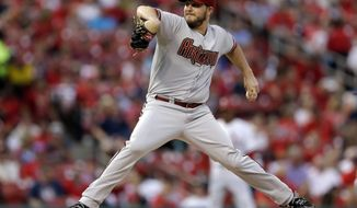 Arizona Diamondbacks starting pitcher Wade Miley throws during the first inning of a baseball game against the St. Louis Cardinals Thursday, May 22, 2014, in St. Louis. (AP Photo/Jeff Roberson)
