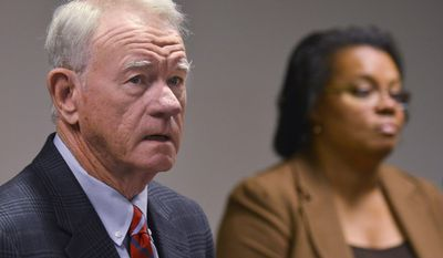 U.S. Attorney George Beck and Veronica Hyman-Pillot, special agent in charge, IRS Criminal Investigation, hold a press conference on Thursday, May 22, 2014, in Montgomery, Alal, to announce  charges against 10 people from Alabama and Georgia accusing them of conducting a $20 million tax fraud scheme using stolen identities. (AP Photo/Montgomery Advertiser, Lloyd Gallman)