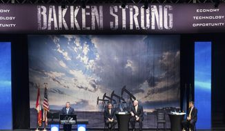 "The ""Bakken Strong"" theme was prevelant as Tommy Nusz, left, chairman and CEO of Oasis Petroleum; Harold Hamm, second from left, chairman of Continental Resources Inc., and and Jim Volker, chairman and CEO of Whiting Petroleum, speak Thursday, May 22, 2014, at the 22nd Williston Basin Petroleum Conference oil expo in Bismarck, N.D.. At right is Ron Ness, of the North Dakota Petroleum Council. (AP Photo/Kevin Cederstrom)"
