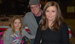 In this photo taken March 21, 2014, Wyoming Army National Guard member Thomas Watts, 29, spoke during dinner at the Powell American Legion post in Powell, Wyo. His wife Jessy, right, and their daughter Hayden pose with him for a photo. Watts, , who served nine months in Bahrain with the Wyoming Army National Guard, was the speaker for the event. The American Legion was founded by World War I veterans in France and chartered by Congress in 1919, but as its centennial approaches, the American Legion's future is uncertain. (AP Photo/The Powell Tribune, Tom Lawrence)