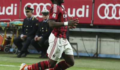 AC Milan midfielder Sulley Muntari, of Ghana, celebrates after scoring during the Serie A soccer match between AC Milan and Sassuolo at the San Siro stadium in Milan, Italy, Sunday, May 18, 2014. (AP Photo/Antonio Calanni)