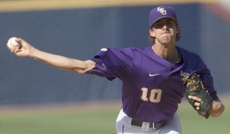 LSU's Aaron Nola pitches against Arkansas during the Southeastern Conference NCAA college baseball tournament on Thursday, May 22, 2014, in Hoover, Ala. (AP Photo/Hal Yeager)