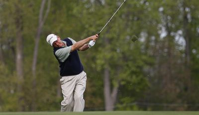 Mark Brooks hits a fairway shot on the 16th hole during the first round of the Senior PGA Championship golf tournament at Harbor Shores Golf Club in Benton Harbor, Mich., Thursday, May 22, 2014. (AP Photo/Paul Sancya)