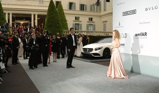 Singer Kylie Minogue arrives at the amfAR Cinema Against AIDS benefit at the Hotel du Cap-Eden-Roc, during the 67th international film festival, in Cap d'Antibes, southern France, Thursday, May 22, 2014. (Photo by Joel Ryan/Invision/AP)