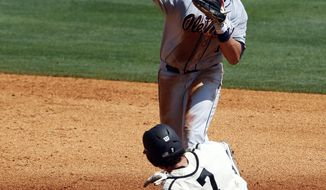Mississippi's Preston Overbey (1) throws to first for a double play as Vanderbilt's Dansby Swanson (7) slides into second base in the third inning during the Southeastern Conference NCAA college baseball tournament on Thursday, May 22, 2014, in Hoover, Ala. (AP Photo/Butch Dill)