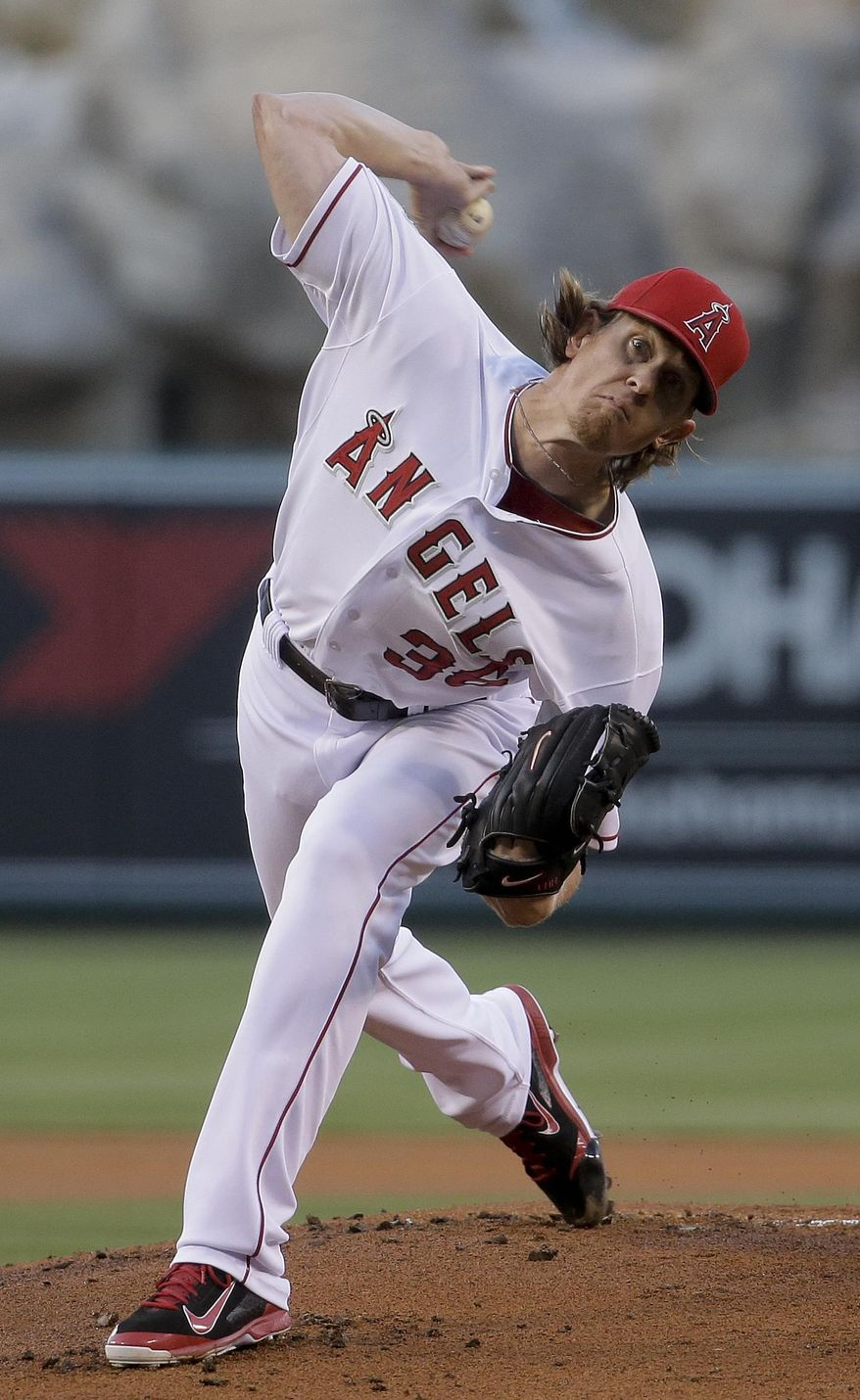 Los Angeles Angels starting pitcher Jered Weaver throws to the Houston Astros during the first inning of a baseball game in Anaheim, Calif., Wednesday, May 21, 2014. (AP Photo/Chris Carlson)
