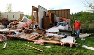 Jeff Bivins, son of homeowner Margaret Krylowicz, gathers a few things from her house that was destroyed after a  storm passed through the area, Thursday, May 22, 2014, in Duanesburg, N.Y. (AP Photo/The Albany Times Union, Cindy Schultz) TROY, SCHENECTADY; SARATOGA SPRINGS; ALBANY OUT.