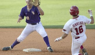 LSU's Alex Bregman takes the throw to force Arkansas' Andrew Benintendi  out at second during the Southeastern Conference NCAA college baseball tournament on Thursday, May 22, 2014, in Hoover, Ala. (AP Photo/Hal Yeager)