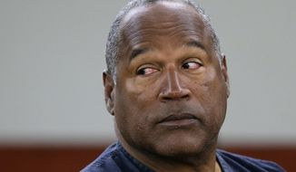FILE - This May 13, 2013 file photo shows O.J. Simpson during an evidentiary hearing in Clark County District Court in Las Vegas. Simpson's lawyers submitted a supersized appeal May 21, 2014, asking the Nevada Supreme Court for a new trial in his 2007 Las Vegas armed robbery case. (AP Photo/Julie Jacobson, Pool, file)