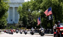 Thousands will ride motorcycles around the monuments Sunday in honor of POWs and MIAs in Rolling Thunder's 27th annual ride. (Associated Press Photographs)