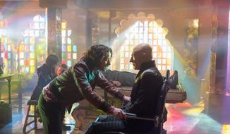 "James McAvoy, left, portraying a young Professor Xavier, interacts with Patrick Stewart, as his future self, in a scene in ""X-Men: Days of Future Past."" (20th Century Fox via Associated Press)"