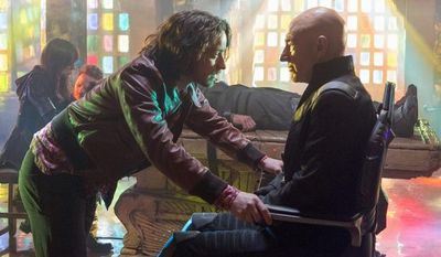 """James McAvoy, left, portraying a young Professor Xavier, interacts with Patrick Stewart, as his future self, in a scene in """"X-Men: Days of Future Past."""" (20th Century Fox via Associated Press)"""