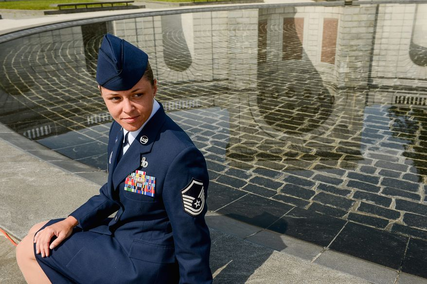 Air Force Master Sgt. Tessa M. Fontaine sits at the Women in Military Service for America Memorial after being honored during a wreath laying ceremony for service women at Arlington National Cemetery Tuesday. (Andrew Harnik/The Washington Times)