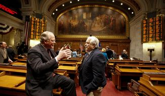 FILE - In this Jan. 25, 2012 file photo Wisconsin Sens. Dale Schultz, left, R-Richland Center and Robert Jauch, D-Poplar, confer in the Assembly chambers at the State Capitol in Madison, Wis. No last-minute surprise retirement announcements are expected as Friday's deadline for incumbents to announce whether they will seek re-election nears. Schultz, who has not yet filed,  said Thursday, May 22, 2014 he still plans on retiring and will get the form in on time. (AP Photo/Andy Manis, File)
