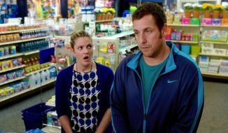 "This image released by Warner Bros. Pictures shows Drew Barrymore, left, and Adam Sandler in a scene from ""Blended."" (AP Photo/Warner Bros. Pictures)"