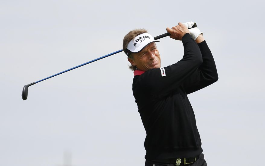 Bernhard Langer watches his tee shot on the first hole during the first round of the Senior PGA Championship golf tournament at Harbor Shores Golf Club in Benton Harbor, Mich., Thursday, May 22, 2014.  (AP Photo/Paul Sancya)