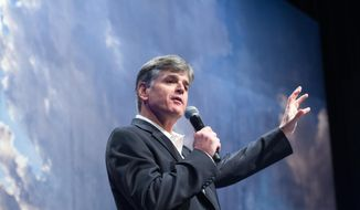 "Political commentator Sean Hannity addresses the crowd while delivering his speech, ""Get America Back to Work"", Thursday, May 22, 2014, during the 22nd Williston Basin Petroleum Conference held in Bismarck, N.D. (AP Photo/Kevin Cederstrom)"