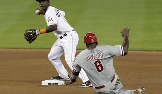 Philadelphia Phillies' Ryan Howard (6) is forced out at second base as Miami Marlins shortstop Adeiny Hechavarria prepares to thow to first base in the inning of a baseball game in Miami, Thursday, May 22, 2014. (AP Photo/Alan Diaz)