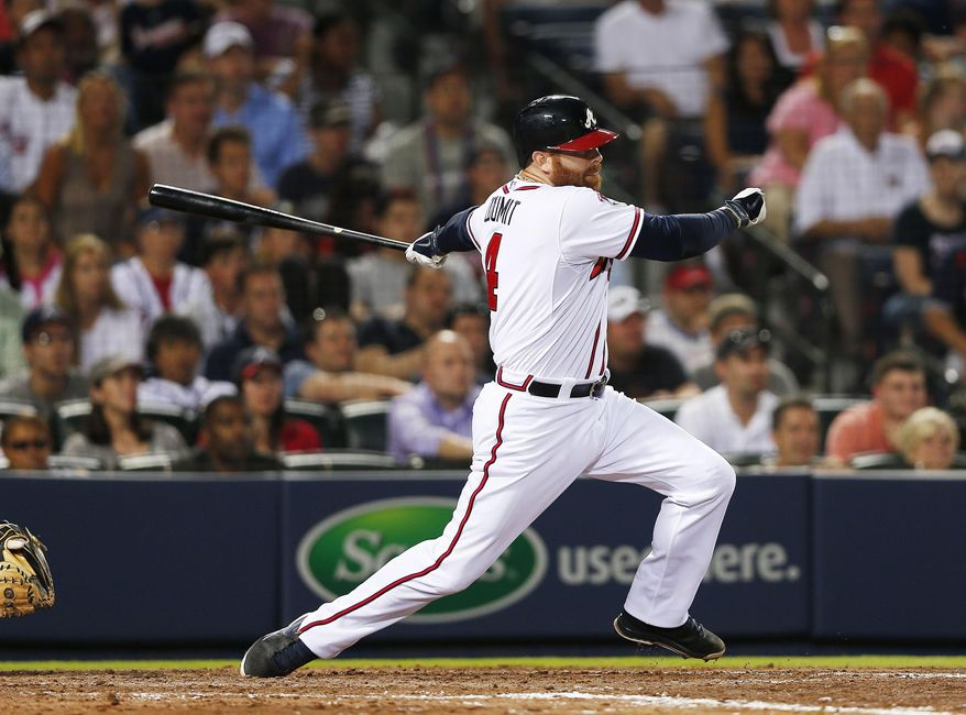 Atlanta Braves pinch hitter Ryan Doumit puts the Braves ahead with a two-run base hit in the seventh inning of a baseball game against Milwaukee Brewers Thursday, May 22, 2014, in Atlanta. (AP Photo/John Bazemore)