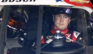 Kurt Busch waits in his car before practice for Sunday's NASCAR Sprint Cup series auto race at Charlotte Motor Speedway in Concord, N.C., Thursday, May 22, 2014. (AP Photo/Terry Renna)