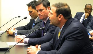 Former NFL players Kevin Mawae, left, and Ernie Conwell, right, and lobbyist Alton Ashy represented the NFL Players Association in its opposition to a workers compensation bill pushed by New Orleans Saints owner Tom Benson, Thursday, May 22, 2014, in Baton Rouge, La. The Senate labor committee narrowly voted in favor of the bill. (AP Photo/Melinda Deslatte)