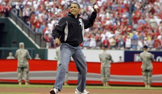 President Barack Obama throws out the first pitch to St. Louis Cardinals first baseman Albert Pujols, not pictured, before the MLB All-Star baseball game in St. Louis, Tuesday, July 14, 2009. (AP Photo/Haraz N. Ghanbari)