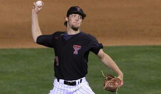Texas Tech pitcher Johnathon Tripp pitches in the eighth inning of a first-round game against Texas in the Big 12 conference NCAA college baseball tournament in Oklahoma City, Wednesday, May 21, 2014. Texas won 8-3. (AP Photo/Alonzo Adams)