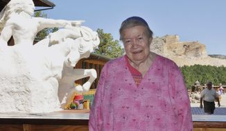 FILE - In this Aug. 21, 2010 file photo, Ruth Ziolkowski, president and chief executive of the Crazy Horse Memorial, stands in front of a plaster rendering of Crazy Horse with what will be the world's largest mountain carving in the background, near Custer, S.D. Ziolkowski is the widow of sculptor Korczak Ziolkowski, who started the memorial on June 3, 1948. Ruth, who took over the dream of her husband, upon his death in 1982 and turned it into a multimillion-dollar operation that draws more than a million visitors a year, died Wednesday May 21, 2014 at age 87 acording to a spokesman. (AP Photo/Dirk Lammers, File)